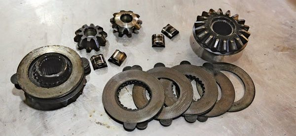 This Eaton limited-slip has been disassembled so you can see the component parts. The side gears are the larger gears; the spider gears are the small ones. The friction plates and metal spacer plates are in the center.