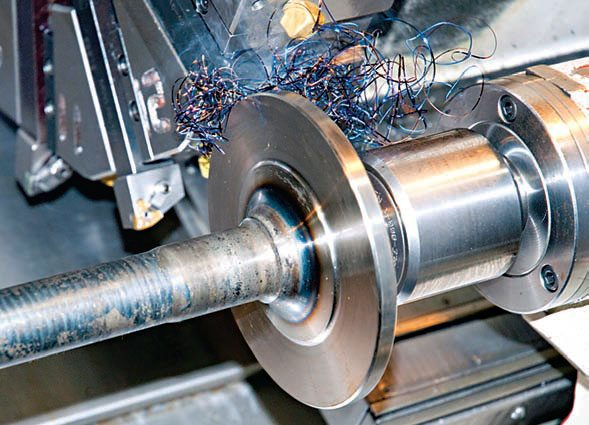 Each axle is turned on a lathe to provide the right bearing surface and wheel-mounting surface.