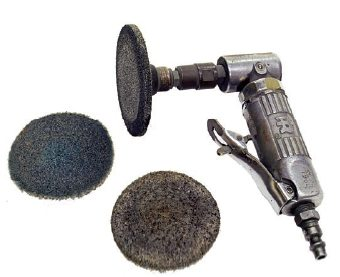 An angle grinder equipped with abrasive discs is one of the best inventions of modern times for cleaning off stubborn gaskets from machined surfaces. The discs are available in several different materials so they do not damage the soft aluminum surfaces.