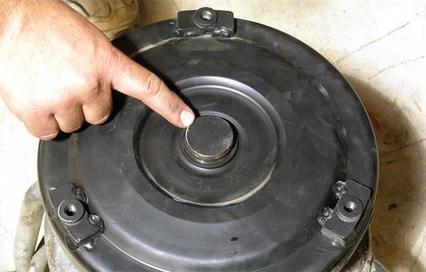 If a new torque converter is being installed, be sure to measure the front hub on the torque converter and the recess on the back of the crankshaft. Before installing the transmission, a test fit between the two components is a good idea.