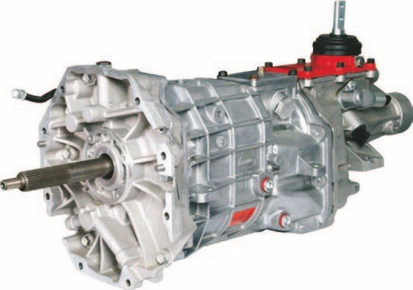 The Tremec 6-speed is a worldclass gearbox that is capable of withstanding 450 to 500 ft-lbs of torque on a daily basis. They use the latest synchronizer gear technology, and fibrous materials replace the old-school Muncie brass blocker rings. Dexron automatic transmission fluid lubricates the internals for minimum internal resistance, saving a few ponies while rotating the shafts. Used T-56 transmission availability is also pretty good. The T-56 in a Shark chassis has a removable crossmember. Physically the transmission is a tight fit in the transmission tunnel, without any modifications to the transmission or tunnel. The toughest part of the installation is the transmission crossmember-mount conversion.