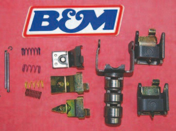 This B&M governor recalibration kit is ready to be installed on the governor. The kit comes with different-tension springs and weights to make the shift occur earlier or later. Governor fluid pressure acts with the valve-body fluid pressure moving shift valves to control shift timing. Governors spin at output shaft speed trying to force the centrifugal weights outward as speed increases. Heavier weights make the centrifugal event happen sooner; in turn, the shift point is lower. Lighter weights require increased output shaft speed; consequently, the transmission shifts later. If your engine performance work raised the torque curve you want the shift points to occur later to utilize the torque curve benefits of the new camshaft. The governor controls the shift points after approximately half throttle. You can still ease through parking lots if you modify the shift points without the fear of the engine revving to 5,500 just to move from one parking space to the other. The beauty of this modification is you can tailor the shift speeds to your liking without having to deal with a pan full of hot transmission fluid each time you make a change. A small amount (a tablespoonfull at most) of fluid comes out when the cover is removed.