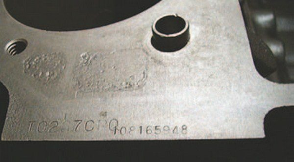 "The stamp on the engine ID pad extension in front of the passenger-side cylinder head provides clues to the block's origin: T0227CRO. The first letter indicates the engine plant, T for Tonawanda (all bigblocks are assembled at Tonawanda). The 0227 indicates the assembly date, February 27. The three-letter suffix code ""CRO"" indicates a 1970 360-hp LS5 454 engine with automatic transmission. (Photo Courtesy Vintage Big Blocks)"