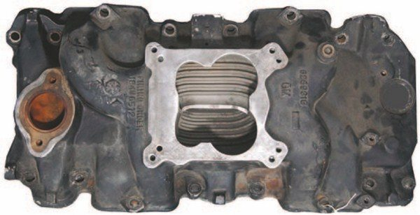 Records indicate this aluminum intake (casting number 6269318) is a Holley high-rise rectangular-port flanged performance manifold, but it appears to have been modified with the center divider cut down, the flange re-drilled, and the throttle bores enlarged to accept a Q-Jet carb. Modified manifolds should generally be avoided regardless of the application. (Photo Courtesy Vintage Big Blocks)