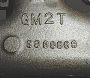 Casting numbers are found on the outer side of the exhaust manifold. This one reads 3969869. It belongs on the driver's side of a 1970–1974 454 Corvette