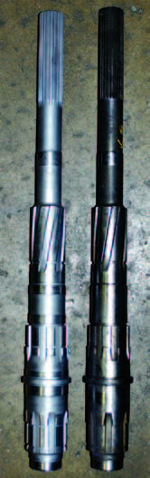 Two 1963 Muncie mainshafts are shown here. An original 1963 shaft is shown at right while a rare BorgWarner replacement shaft is at left; it has an added oil cavity on the first-gear section. Notice that these shafts only have enough room for the speedometer drivegear to press onto them in one place. This means that they can only be used with extension housings that have a driver-side speedometer gear.