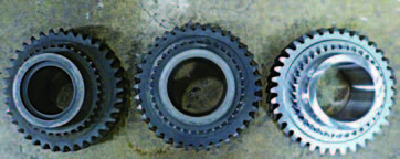 These are three first-speed Muncie gears. The far left gear is a 1963 type that has the recess for the 1-2 synchronizer snap ring and a smaller bore. The middle gear is the laterstyle original-equipment late-1964 to 1974 gear. On the right is an aftermarket gear made in Taiwan.
