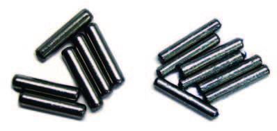 The 1963–1965 needle countergear needle bearing on the left is .156 inch in diameter. Four rows with 20 needles per row were used. The later design reduced the diameter of the needle to .125 inch because of the larger countershaft, which used four rows with 28 needles per row.