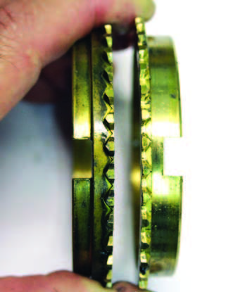 Notice the thicker shoulder of the later-style ring (left). The early ring (right) had a problem: Cracks developed at the key slot. Mixing early rings with a late hub causes excessive clearance and ring damage.