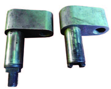 The left shifter shaft has a 3/8-24 threaded stud with machined flats on both sides. The 1969-and-up shafts used a bolt-on style, which eliminated broken studs and stripped threads.