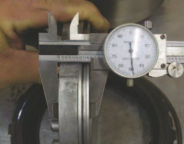 Dial calipers are for measuring thickness or size. They also can be used to measure depth. A good pair is pretty much a mandatory item for transmission rebuilding because you need to measure the thickness of friction and steel plates when stacking clutch drums.
