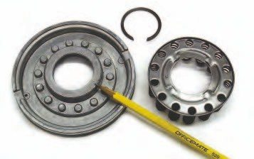 An apply piston is used within a clutch drum to compress the confined steel and friction plates. Pressurized oil is routed behind the piston, causing it to move and apply force to the clutch pack. The clutch pack must overcome spring pressure. A spring cage, held in place with a snap ring, is used to move the piston away from the clutch pack when the fluid pressure is removed from behind the piston.