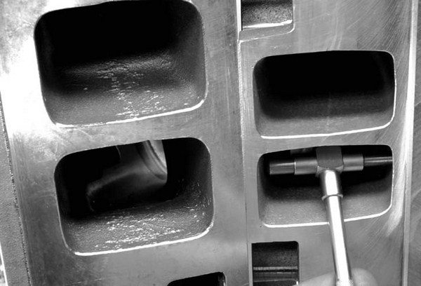 Rectangle-port Rat heads are a classic example of a too-large port. A rectangle port Rat head always outflows a small-block head on the flow bench, but with a monstrous 3.2 square inches of area (or larger), flow velocity is virtually snail-like and volumetric efficiency (VE) suffers. We've seen Rat motors pick up tons of torque and lose minimal peak HP by using smaller, oval port heads (despite their lower flow numbers). That proves the point. Yet somehow, the big-block guys still want those big heads. Go figure….