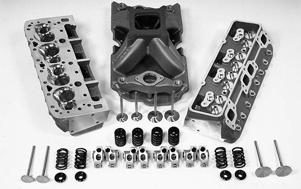 Always think of an engine as a complete system. That means carefully matching the intake manifold, carb, cam, heads, compression, and exhaust as one unit and the engine generally runs better than an engine that has been cobbled together. These are Dart 18-degree heads along with their required valvetrain and intake. These alternate valve angle heads used to be considered exotic race-only pieces, but they do show up on the street on rare occasions.