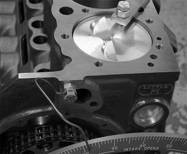 Many cam specs are referenced in relationship to TDC on the Number One piston. This is the driver side front cylinder on a small-block Chevy. Using a piston stop, you can determine the exact position of TDC on a degree wheel or use this check to ensure that the TDC mark on the engine balancer is accurate.