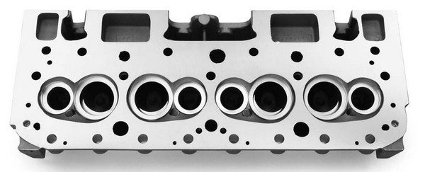 Race heads also create a much more shallow combustion chamber that allows the engine builder to create higher compression ratios without using domed pistons. This is the GM Performance Parts 18-degree head. Most race heads come semi-finished without seat inserts so the cylinder head porting professional can use the inserts of his choice.