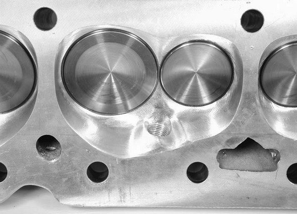 It's difficult to measure how much a chamber is worth, but clearly this new generation of heart-shaped chambers is not as deep and tends to enhance mixture movement across the spark plug and toward the exhaust side. This is the new AFR 210 Eliminator chamber.