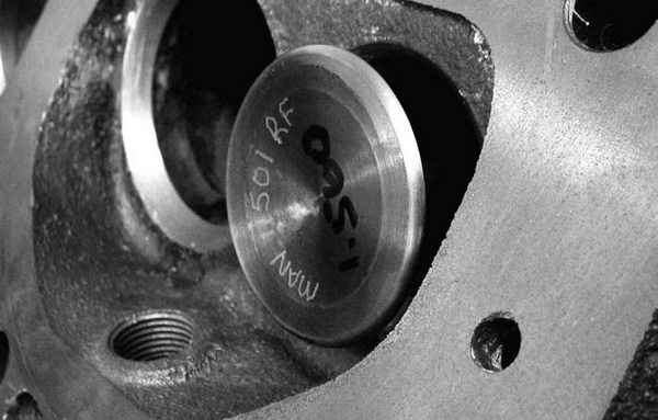 There is some evidence to show that a radius on the face of the exhaust valve offers some exhaust flow improvements. This becomes a situation where individual exhaust ports or applications will dictate its use. Don't be afraid to try this to see if it works.