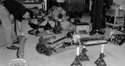 the differential, transmission, and torque tube have been removed as one  unit from the rear frame cradle