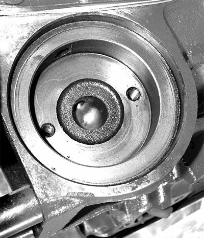 the oil filter mounting pad is sometimes blueprinted by radiusing the entry  holes, but it's most critical that the surfaces remain smooth and flat so  the