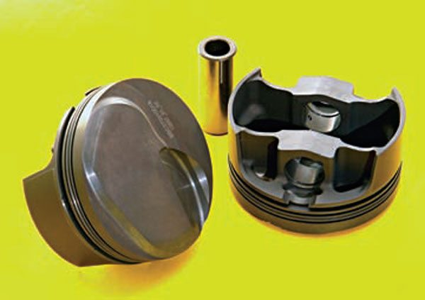 Fig. 2.11. These Mahle pistons have a crown shape that is on the way to emulating the recommended form. As such, they are a very effective piston right out of the box. In addition to a good crown and valve cutout form, these pistons come with 1.5-mm-wide compression rings, which typically have less bore drag than the 1/16-inch-wide rings.
