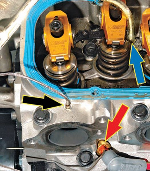 Fig. 12.3. The pressure readings were taken from these points on the 525-ci big-block. The blue arrow is the intake port tapping. The black arrow is the exhaust tapping. The red arrow is the pressure transducer/spark plug. With this equipment, you can see (virtually) inside the engine to determine what is going on.