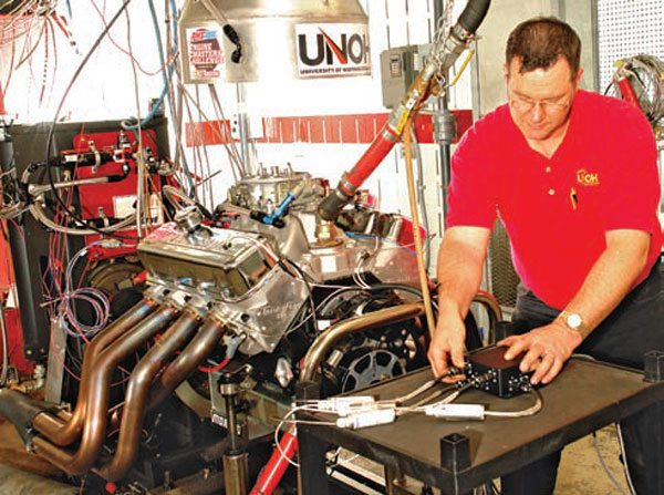 Fig. 12.4. Randy Lucius, the University of North-western Ohio's Engine Sports instructor, puts the finishing touches to the installation of the TFX pressure-measuring equipment on the 525 dyno mule.
