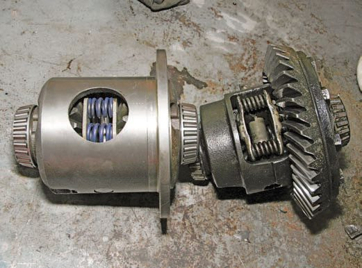 A stock Posi-Traction unit (right) compared to an aftermarket carrier (left) shows the strength of the aftermarket unit. The extra material on the case makes for a stronger carrier, with bigger gears and springs. This carrier is a Yukon clutch-type limited-slip differential.