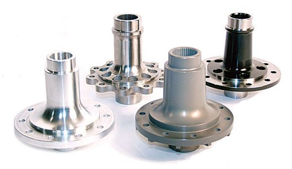 Moser offers several types of spools (left to right): aluminum ultralight, ultra-light steel, full-weight steel, lightened steel. The only difference between a full-weight steel spool and a lightened steel spool is weight; they are equally strong. All of them handle unlimited horsepower, but the aluminum spool eventually wears out the ring-gear bolt holes. (Photo Courtesy Moser Engineering)
