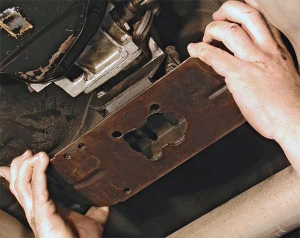 Once the transmission is bolted to the bellhousing, raise the transmission just far enough to work the crossmember under it and align/install the bolts.