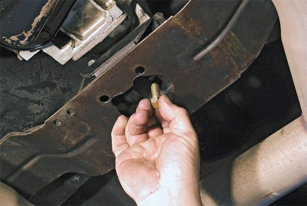 Install all of the bolts that go through the crossmember to the frame, but do not tighten them. This allows some latitude to align the crossmember to transmission mount bolts. Once all of the fasteners are installed, tighten the crossmember bolts first, and then tighten the bolts to the transmission rear mount.
