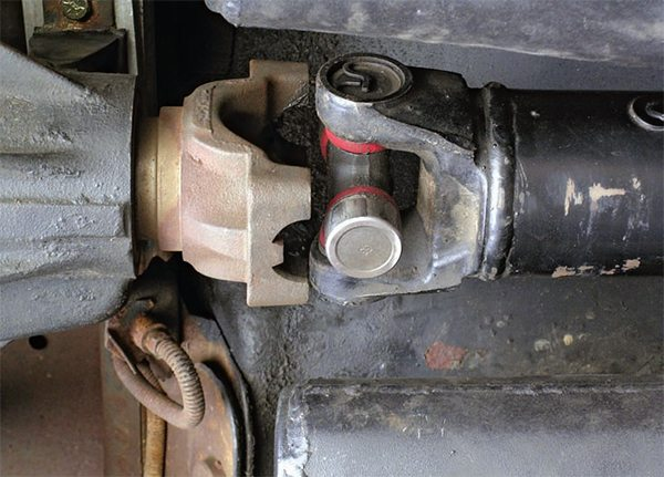 With the driveshaft fully seated into the transmission, there should be approximately 3/4-inch clearance between the U-joint ends and the yoke. If the driveshaft is too short, it can come out of the transmission when the suspension reaches full height. If the driveshaft is too long, it can bottom out in the transmission and damage the transmission thrust bearings.