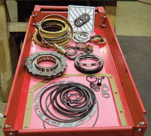 A roll-around cart makes a great place to keep your rebuild kit and other parts clean and separated from the work area.