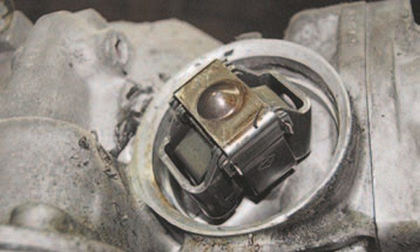 This is what the automatic transmission governor looks like when the cover is removed. The Turbo-Hydramatic 350 transmission (shown) has a round belltype cover that presses on with a metal bail to keep the cover in place. The 350 governor is on the driver's side of the transmission above the pan rail close to the extension housing. The turbo-hydramatic 400 has a similar governor placed in a similar location on the passenger's side of the transmission with a cover that is held in place with four 1/2-inch hex-head screws. Turbo 350 and 400 governors cannot be interchanged because of their placement: one rotates counterclockwise and the other clockwise while driving in forward gears. Try to prevent dirt from entering; if it does remove as much as possible before covering things up.