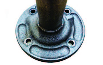 This is not a Muncie 4-speed retainer. It is from a Saginaw 3-speed, casting number 591620. It can be used as an adapter-bearing retainer. It was an old trick to enable small-retainer transmissions to correctly pilot to largeretainer-bore bellhousings. If you attach a small-retainer transmission to a large-bore bellhousing the transmission is not piloted correctly. Typically, the front bearings shatter and input shafts break teeth, usually at the end if this mistake is made. This adapter retainer can be used to attach a 1963 Muncie to a later bellhousing. You can also turn down the outside diameter on a lathe to replace the rare 3790278 or 604932 retainers.