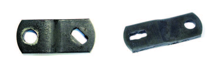 Notice the difference in the drive slots of these arms. The example on the left is for pre-1969 transmissions and the one on the right is for those that accept a 3/8-16 threaded bolt. The slot on later arms always has a circular cutout to make room for the bolt. Adapter clips are available to take up the extra space so you can use later arms on stud-type shifter shafts.