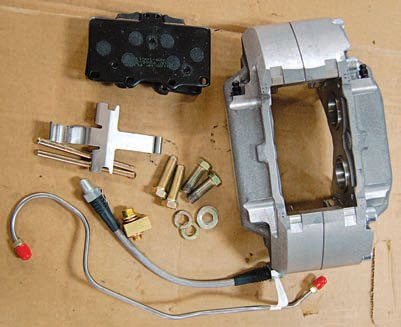 This all-aluminum, four-piston SSBC caliper is a direct bolt-on for a 1968–1982 Shark. Caliper piston size is similar to factory calipers for excellent brake balance right out of the box. Each caliper comes with the pieces shown for an easy installation. SSBC also supplies the stainless-steel hoses and proper fi ttings to connect to your original lines. The straight-thread fi ttings are a nice touch for high-pressure sealing long term. SSBC added a wear indicator squealer to the pads so you know the pads are low before rotor damage occurs. At about $800 an axle the calipers aren't inexpensive but well worth the investment long term and they come in different colors for open-spoke wheels.