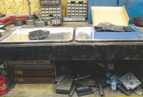 A suitable working surface is a must for building transmissions. You need a heavy-duty table or workbench to effectively support the weight of the transmission if a holding fixture is used. The more surface area on the top of the bench the better; it allows you to keep the parts separated and organized during the procedure.