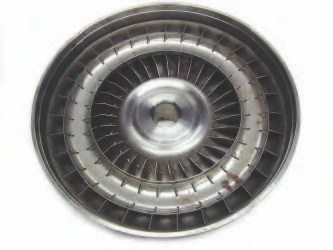 The torque converter pump or impeller is built into the rear portion of the outer shell. It uses a series of vanes to move transmission fluid, much like a fan moving air away from it in a room. Since the fluid being moved is oil, it is used to transfer mechanical energy created by the engine to the transmission's input shaft.