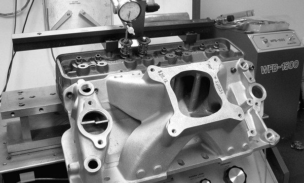 Flowing an intake manifold on the head to measure flow reduction is a good way to judge the effectiveness of the intake. A single-plane-style intake will always test better than a dual plane, so the best test is to see which style intake among dual planes or single planes is the best.