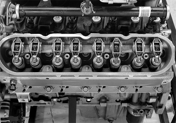 We've come a long way from the original 265-ci small-block to the current 400 hp GEN IV engine in all areas, but especially in the valvetrain. The GEN III and IV engines now use a rocker shaft that ties the rocker arms together, compared to individual stud-mounted rockers of the original engine. This system has advantages and disadvantages.