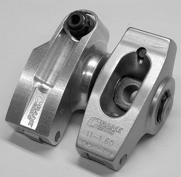 The key to any shaft rocker system is the increased fulcrum length of a shaft rocker versus a studmounted rocker of the same ratio. This is because the shaftmounted system can be relocated away from the valve to increase this distance. The difference can be as much as 0.070 to 0.150 of an inch increase in fulcrum length and is seen in the longer fulcrum shaft rocker on the left.