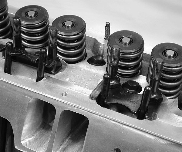 There are two basic types of pushrod guideplates—the more common flat style (right) and the stepped version (left).