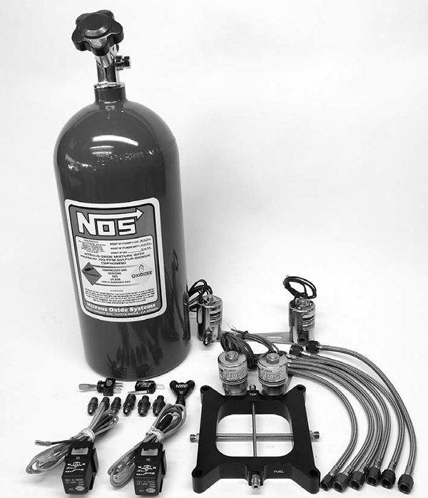 """Nitrous is by far the simplest and easiest of the power-adders. This is a Nitrous Oxide Systems two-stage 250 to 500 hp """"Double Cross"""" plate system. These bolton systems work extremely well and make tons of torque along with the horsepower as long as they are installed properly and the electrical connections are rock solid."""