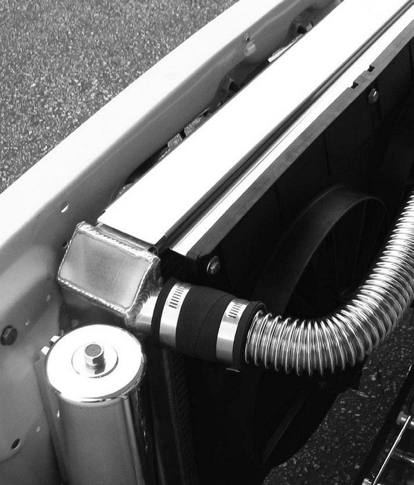 While cooling system details may not sound like glamorous HP components, the truth is that a big fiberglass or aluminum flex fan can eat 10 to 15 hp! A much smarter approach is a large aluminum radiator and a pair of electric fans.